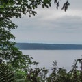 A peek at the Puget Sound and Whidbey Island from the Bluff Trail.- Cama Beach State Park Loop Trails