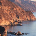 A sunset lights up the coastline near Julia Pfeiffer Burns State Park.- Julia Pfeiffer Burns State Park