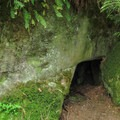 A small cave underneath a boulder.- Rock Trail