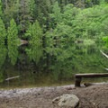 A bench on the east shore.- Fragrance Lake Trail