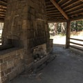 Historic CCC shelter at Camp Sherman Campground.- Camp Sherman Campground