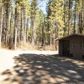 Vault toilet facility in Smiling River Campground.- Smiling River Campground