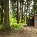 Vault toilet facility serving walk-in campsites in Paradise Point State Park Campground.- Paradise Point State Park Campground