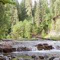 This small ledge drop rapid is directly adjacent to the most open site at Cleator Bend Group Campground.- Cleator Bend Group Campground