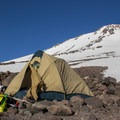 An ideal base camp lies on the route between 9,800 and 10,000 feet. The camp is adjacent to a stream that typically flows by late spring.- Mount Shasta: Hotlum-Wintun Ridge