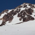 Skiers ascend the Hotlum-Wintun Ridge route below Lunch Rocks.- Mount Shasta: Hotlum-Wintun Ridge