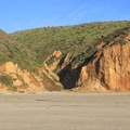 McClures Beach is backed by highly featured and eroded sandstone bluffs.- McClures Beach