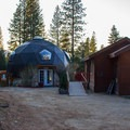 The Temple Dome Pool Area houses an adjacent changing room and shower building.- Sierra Hot Springs