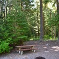 A picnic area near parking lot.- Diamond Creek Falls