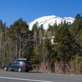 Red Lake Peak rises above Highway 88 and the lower approach parking pullout.- Red Lake Peak: Crater Lake Descent
