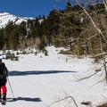 Skinning up Alpine Mine Road with Red Lake Peak (10,061') rising in the distance.- Red Lake Peak: Crater Lake Descent