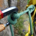 Anchored to the belay station on Rooster Rock.- Rooster Rock Climbing Crag