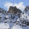 Rugged granite ridges rise above Pear Lake.- Wolverton to Pear Lake Ski Hut