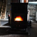 The hut's heating source, a wood-pellet stove.- Pear Lake Ski Hut