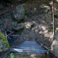 The metal ladder down into the entrance of the cave.- Skylight Cave