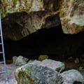 At the base of the entrance. Head left to the skylights or right to see how far you can get.- Skylight Cave