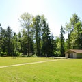 Central lawn and restroom/shower facility in Dash Point State Park Campground.- Dash Point State Park Campground