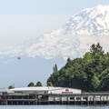 View of boat dock and Mount Rainier (14,410') from Owen Beach and Promenade.- Owen Beach + Promenade