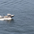 View of a fishing boat on the Dalco Passage from the Point Defiance Outside Loop Trail.- Point Defiance Outside Loop Trail