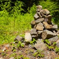 A cairn marks the junction between the trail and the old road.- Fish Creek Mountain