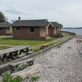 Standard waterfront cabins at Cama Beach State Park.- Cama Beach State Park Cabins
