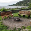 The beach area at Cama Beach State Park has three shared fire circles.- Cama Beach State Park Cabins