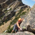 The fun fourth-pitch wide crack.- South Early Winter Spire: Southwest Rib