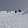 The last couple of steps up the Old Chute bootpack.- Mount Hood: West Crater Rim Descent