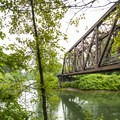 Snoqualmie River and Snoqualmie Valley Trail bridge.- Three Forks Natural Area + Dog Park