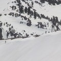 Skiers gaining Lassen's south ridgeline.- Lassen Peak: Southeast Face Backcountry Ski