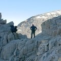 Resting in a notch on the way to Mount Whitney's summit.- Mount Whitney, Cottonwood Pack Station