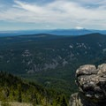 Looking south from the summit to Mount Jefferson (10,495') and the Three Sisters.- Lookout Mountain from High Prairie