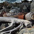Riprap and driftwood along the jetty.- Coquille River Lighthouse