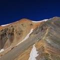 Saddle viewpiont, looking south to Redcloud Peak (14,035').- Redcloud Peak + Sunshine Peak