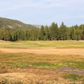 The pools are adjacent to a scenic meadow.- Grover Hot Springs