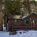 Tamarack Lodge offers historic and delux cabin rentals.- Tamarack Lodge
