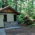 Vault toilets at Tinkham Campground.- Tinkham Campground