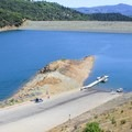 Lake Sonoma public boat ramp with Warm Springs Dam in view.- Lake Sonoma Recreation Area