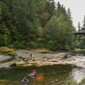 Relaxing on a hot day in the South Santiam River.- Cascadia State Park Swimming Hole