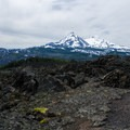 North Sister (10,085') and Middle Sister (10,047') seen from the trail.- Little Belknap Crater