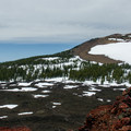 Panorama from summit: looking west at Belknap Crater (6,877').- Little Belknap Crater