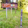 Signs leading to Huckleberry Mountain Campground.- Huckleberry Mountain Campground