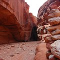 A cairn marks a popular side canyon exploration.- Green River, Labyrinth Canyon