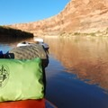 Overnight gear loaded onto an inflatable stand-up paddleboard.- Green River, Labyrinth Canyon