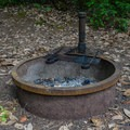 Firepits in the campsites at Ludlum Campground.- Ludlum Campground