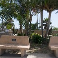 Series of benches at the street level of the park.- Swami's Beach