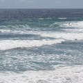 Only a few surfers on a hot summer day.- Swami's Beach