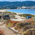 View of Del Monte Beach and Monterey from above the parking lot.- Del Monte Beach