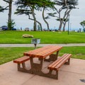 Picnic tables and barbecue pits at Lovers Point Park.- Lovers Point Park