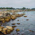 Rocky shoreline at Lovers Point Park.- Lovers Point Park